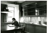 Student in treasure room in Wollman Library, circa 1963