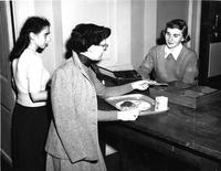 Barnard Cafeteria, students paying for food, circa 1948