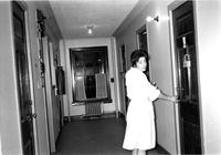Student in corridor of Hewitt and Brooks, circa 1990s