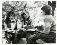 Three Students on Bench by gates, 1976