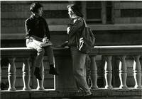 Students sitting on wall on Lehman Lawn, circa 1990s