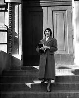 Student standing in front of Milbank Hall, circa 1950