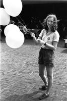 Student holding balloons, circa 1980s