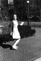 Candid portrait of student on Lehman Walk, 1965