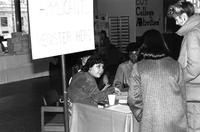 Students at booth for activities fair, circa 1980s.