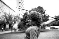 Student throwing javelin on Lehman Lawn, circa 1980s