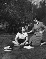 Two students posing on Lehman Lawn, 1954
