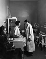 Dr. Alsop administers a physical, Spring 1936