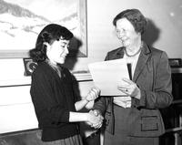 President McIntosh presents certificate to Reiko Kase, circa 1950