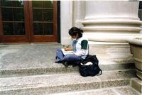 Student sitting on Barnard Hall steps, circa 1990s