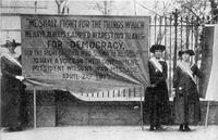 Suffragists from National Woman's Party picketing White House, circa 1917