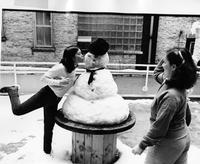 Students with a snowman, Elliott Hall, circa 1990s