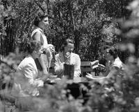 Students sitting at table in the Jungle, 1956