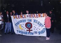 Take Back the Night marchers with banner, circa 1990s