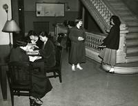 Students next to Milbank Hall staircase, circa 1948-1959