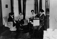 Students having tea in Brooks Hall, 1912