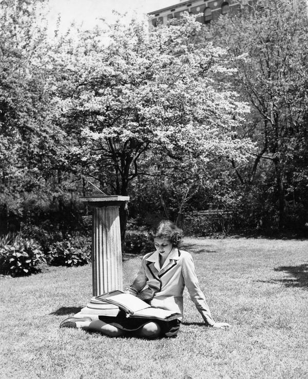 Student studying on grass in the Jungle, circa 1940s-50s
