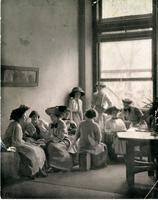 Students relaxing in Fiske Hall (Milbank), circa 1911-1912