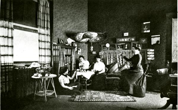 Afternoon tea in a student's room, circa 1900s