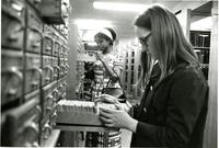 Two students searching in Lehman, circa 1960s