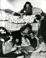 Students congregate in Hewitt Hall dorm room, circa 1940s