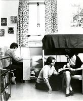 Three students in a Reid Hall dorm room, circa 1960s