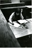 Woman Smoking and Studying in McIntosh Booth, circa 1970