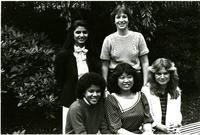 Students pose by bushes on Lehman lawn, circa 1970