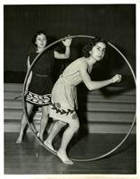 Students pose with hoop during Greek Games, 1952