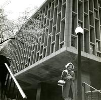 Student exiting newly built Lehman Hall, circa early 1960s