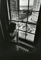Student sits by window in Hewitt Hall, circa 1968-1969