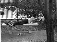Student Relaxing on Bench on Lehman Lawn, 1970s