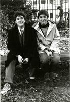 Two students on bench by gate, circa 1980s