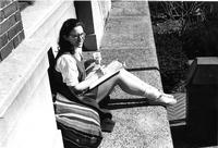 Student relaxing on ledge, circa 1960s