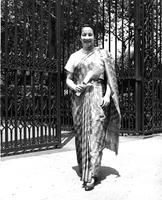 Bhinda Malla walks by Helen Geer Gate, circa 1956