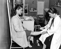 Dr. Alsop taping foot, circa 1945