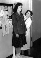Doctor Measures Height of Student, circa 1940