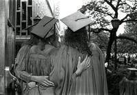 Three students pose at graduation, circa 1993