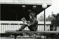 Student sitting outside Altschul Hall, circa 1970