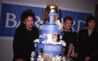 "Laurie Anderson, Joan Rivers, and Suzanne Vega posing with cake at ""Barnard Performs"" benefit, Carnegie Hall, 1989"